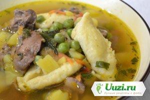 Суп с куриной печенью и клецками Изображение