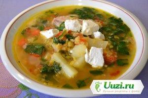 Чечевичный суп со шпинатом и козьим сыром Изображение