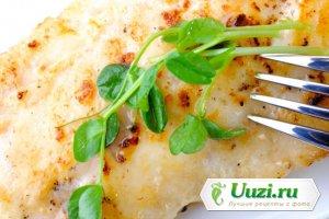 Рыба с овощами под хлебными крошками Изображение