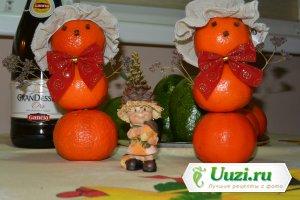 Новогодние снеговики из мандарин Изображение