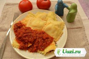 Равиоли с сыром и томатным соусом Изображение