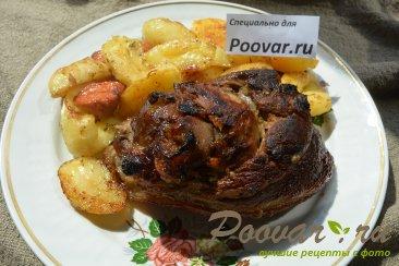 Свиная рулька в пиве с картофелем Изображение
