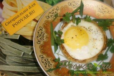 Яйца в луковых кольцах Изображение