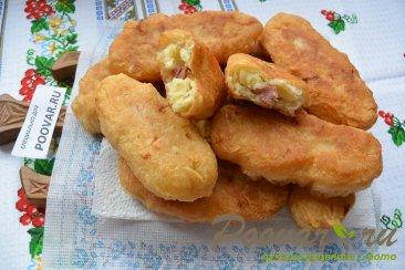 Пирожки с картошкой и сосисками Изображение
