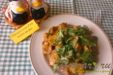 Куриные желудки с луком и томатом Изображение