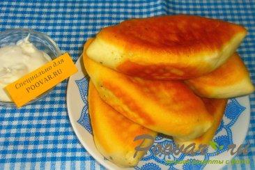 Жареные пирожки с капустой и грибами Изображение