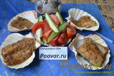 Жареная рыба на сковороде Изображение