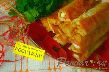 Трубочки из лаваша с колбасой и сыром моцарелла Изображение