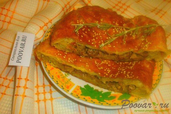 Мясной пирог из слоёного теста Изображение